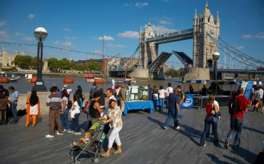 London - People on the Southbank watching Tower Bridge being raised. Photo Credit: ©Pawel Libera/Visit London Images.