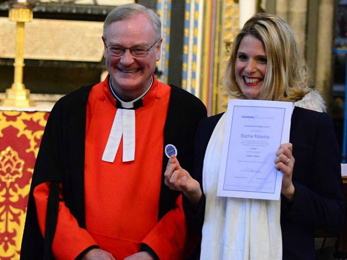 APTG prize winner Sophie Malaria raceiving her Blue Badge from the Reverend David Stanton, Canon of Westminster