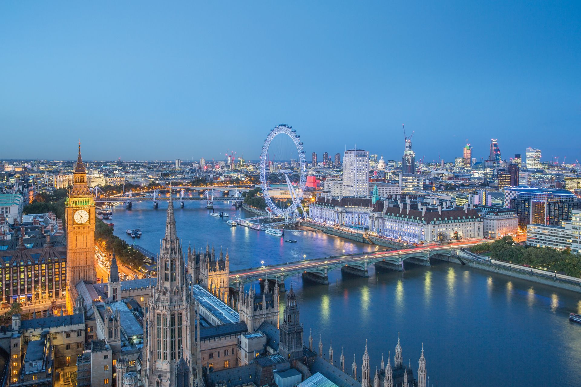 London skyline with Big ben and the London Eye at dusk. Photo Credit: © Julian Love/Visit London Images.
