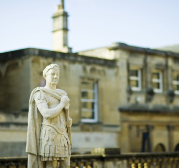 Bath - A close up of a statue outside the Roman Baths, a World Heritage site, at Bath in Somerset., Bath, Bath and North East Somerset, England.