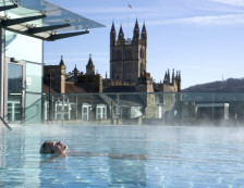 Bath - Woman relaxing in the New Royal Bath at Thermae Bath Spa, Britain's original and only thermal bath spa set in the busy city of Bath, England., Bath, Bath and North East Somerset, England.
