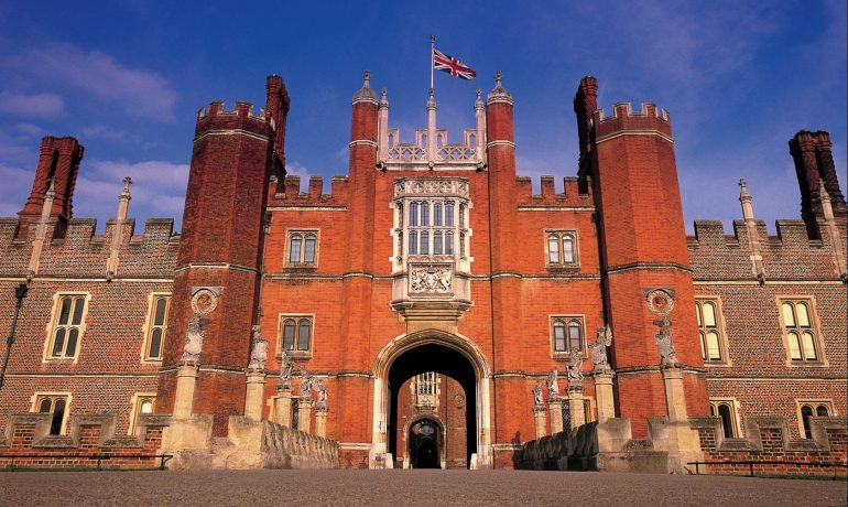 Hampton Court Palace - The bridge over the moat leads to the Tudor west front, which is protected by the King's Beasts.