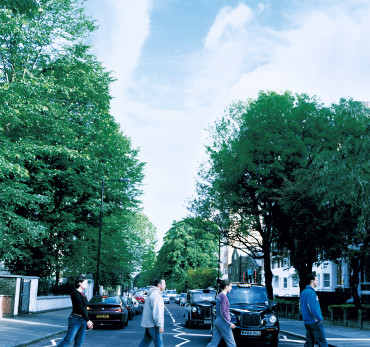 London - Four people using the Zebra Crossing on Abbey road. Photo Credit: ©Jasmine Teer/Visit London Images.