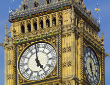 Palace of Westminster - Part view of ornate Victorian gothic architecture of the iconic Big Ben clock tower at the Houses of Parliament, designed by Sir Charles Barry and Augustus Pugin.