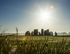 Stonehenge is a UNESCO world heritage site, and a prehistoric ring of huge standing stones within an earthworks, on the plains in Wiltshire.