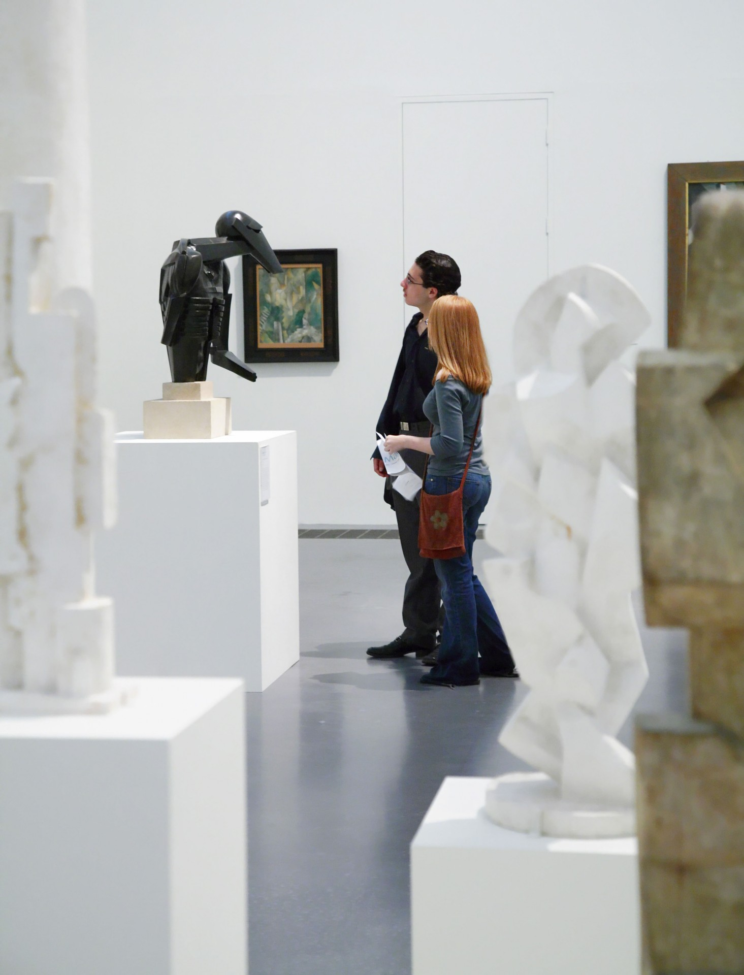 Couple looking at sculpture in the Tate Modern gallery, the national collection of modern and contemporary art housed in a former power station at Bankside, London.