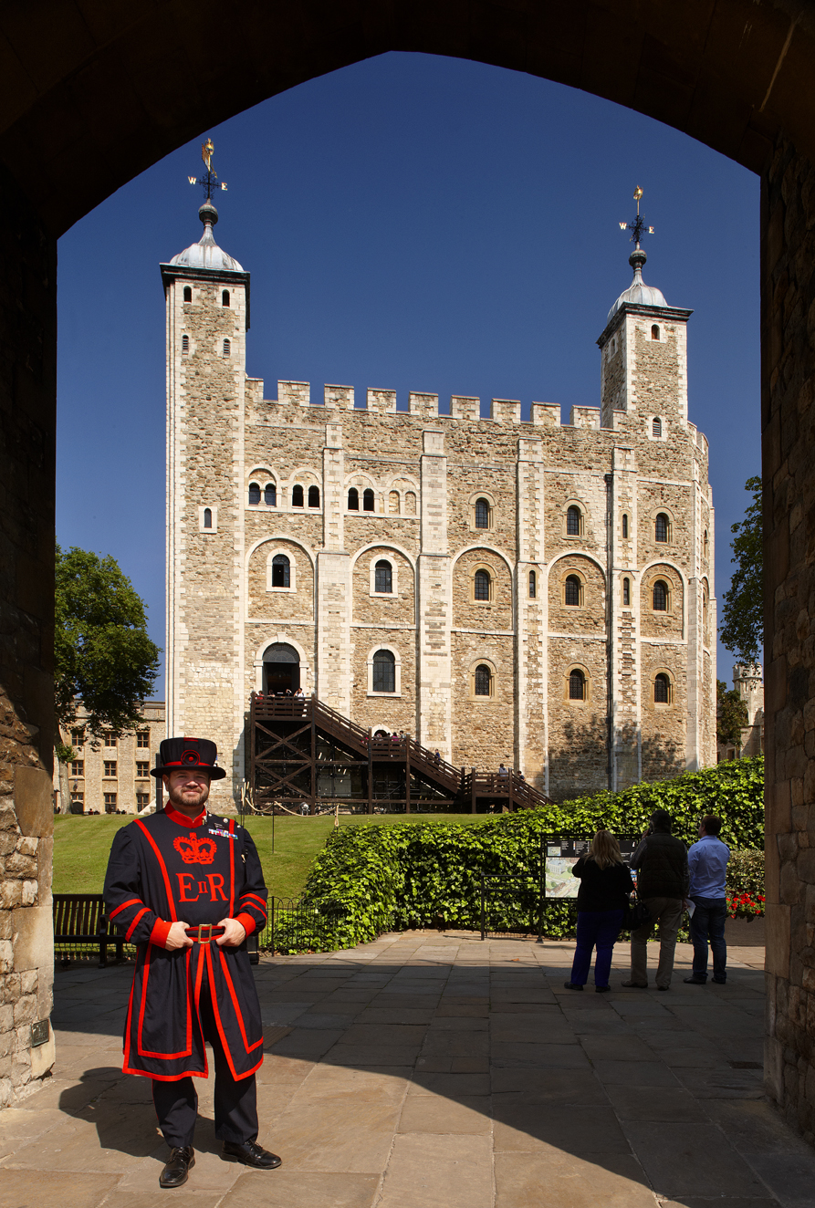 Tower of London - White Tower and Yeoman Warder Shedden. The White Tower was the original Tower of London. Begun by William the Conqueror around 1080, it would have made a safe and impressive home for the newly crowned Norman invader. During its long life - it is almost as old as the Millennium - it has served many purposes including Royal residence, Royal Observatory, Public Records Office, State Prison, gunpowder store and is still home to the Royal Armouries.