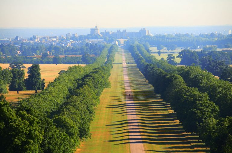 The Long Walk towards Windsor Castle in the distance. The Long Walk was commenced by Charles II from 1680-1685 by planting a double avenue of elm trees. The central carriage road was added by Queen Anne in 1710. It is a little less than three miles long. To the south of Windsor is The Great Park extending over some 14,000 acres of which 8,000 acres are forest. The public areas are predominantly woodland or open grassland.