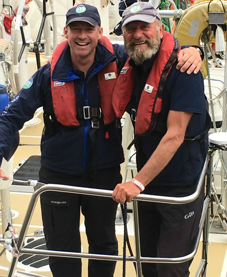 Skipper Greg Miller with Blue Badge Tourist Guide Brian Harlock on return from round the world sailing trip. Photo Credit: ©Liz Rubenstein.