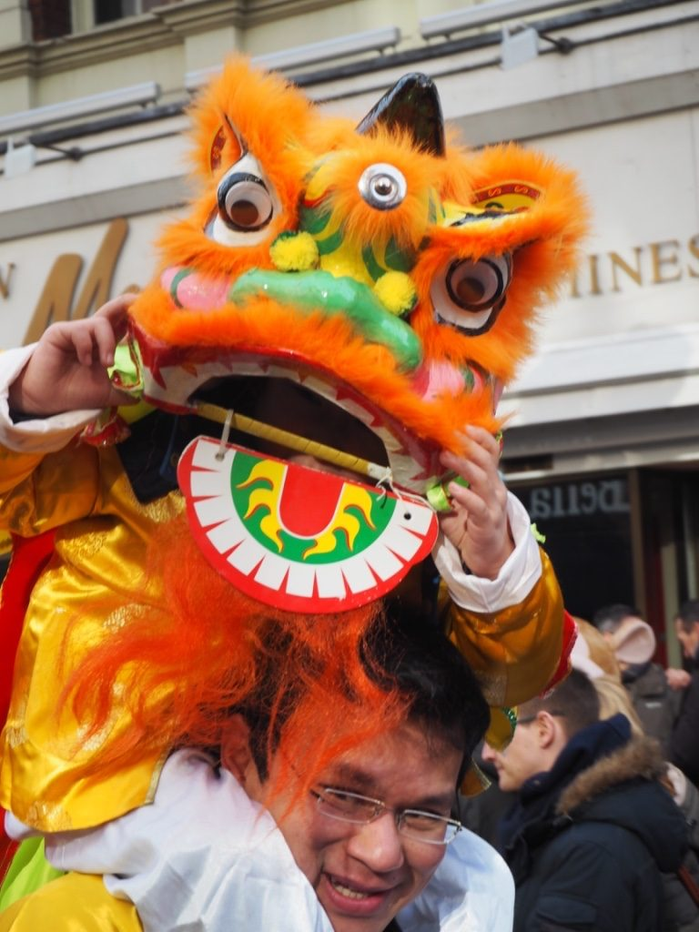 London Chinatown - little girl on her dad's shoulder at Chinese New Year Parade. Photo Credit: © Ursula Petula Barzey.