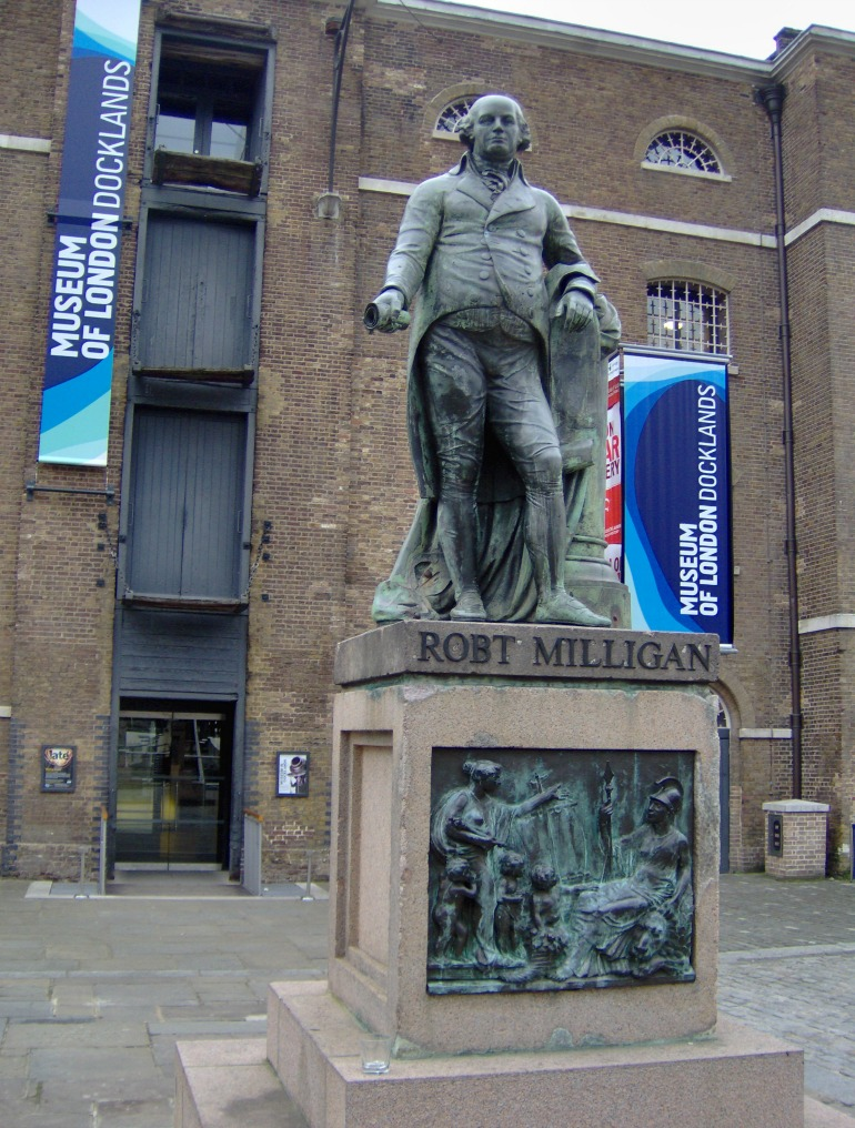 Statue of the English merchant Robert Milligan (1746-1809) in front of the Museum of London Docklands. Photo Credit: © By Tubantia via Wikimedia Commons.