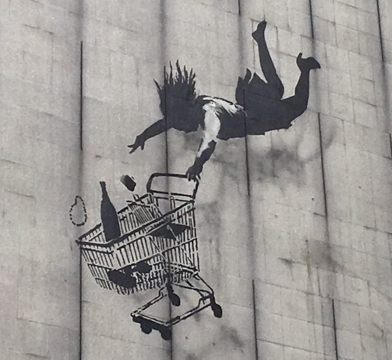 London Street Art: Banksy - A woman and her shopping trolley falling from a great height. Photo Credit: © Ursula Petula Barzey.