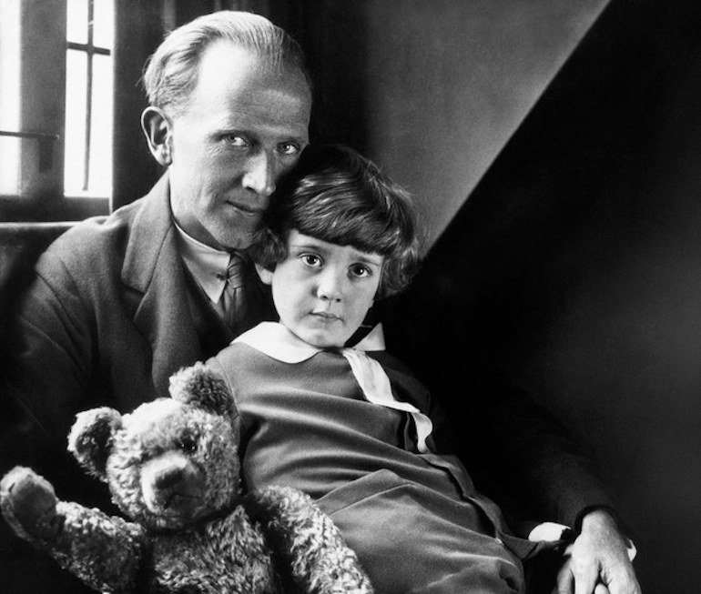 Milne with his son Christopher Robin and Pooh Bear, at Cotchford Farm, their home in Sussex. Photo Credit: © Howard Coster, 1926.