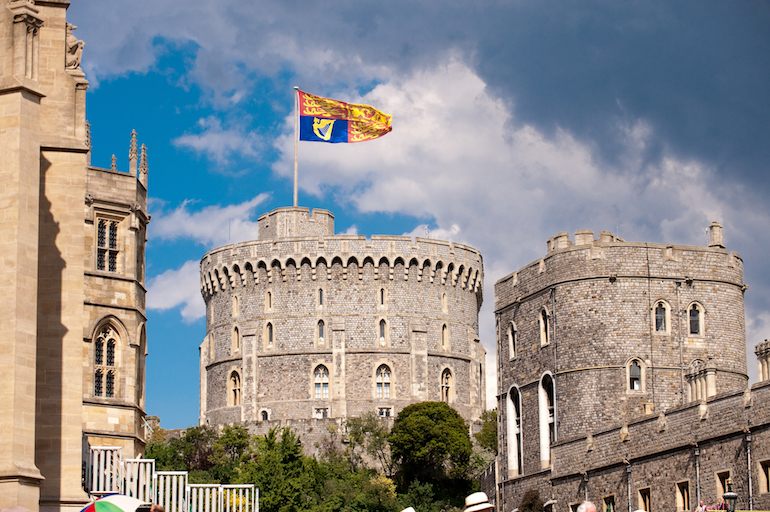 Windsor Castle: The Royal Standard flies at Windsor Castle. Photo Credit: © Visit England/Doug Harding.