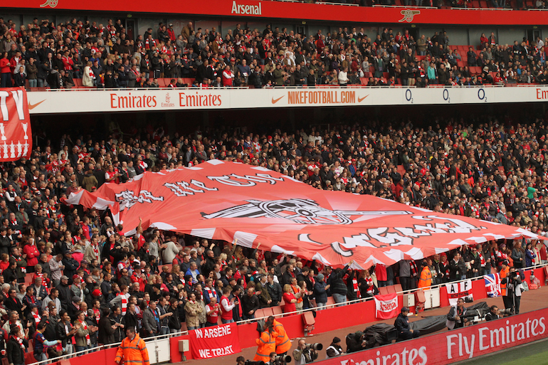 London Football: Arsenal Supporters with Flag.