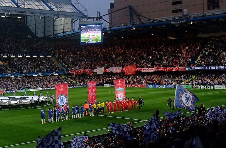 London Football: View from the West Stand of Stamford Bridge during a Champions League game. Photo Credit: © Brian Minkoff via WikiMedia Commons.