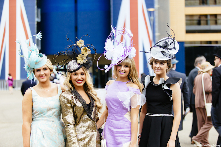 Four young women attending Royal Ascot at the prestigious Ascot racecourse in Berkshire. Photo Credit: © Ben Selway via Visit Britain.