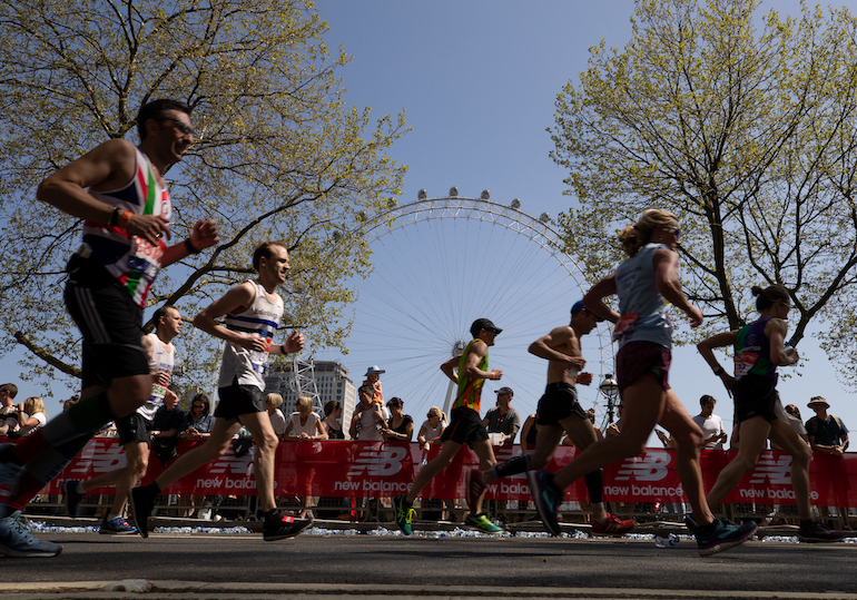 Runners pass the London Eye during the 2018 Virgin Money London Marathon. Photo Credit: © Ian Walton for Virgin Money London Marathon.