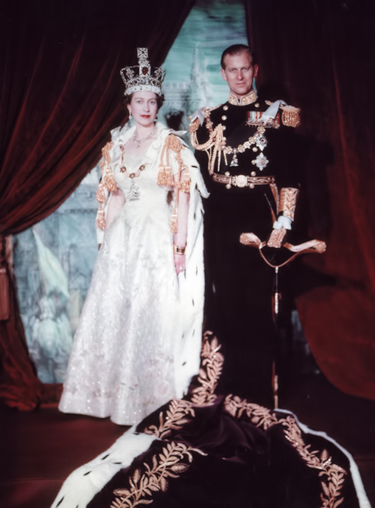 Prince Philip & Queen Elizabeth II wearing the Imperial State Crown after Coronation. Photo Credit: © Public Domain via Wikimedia Commons.