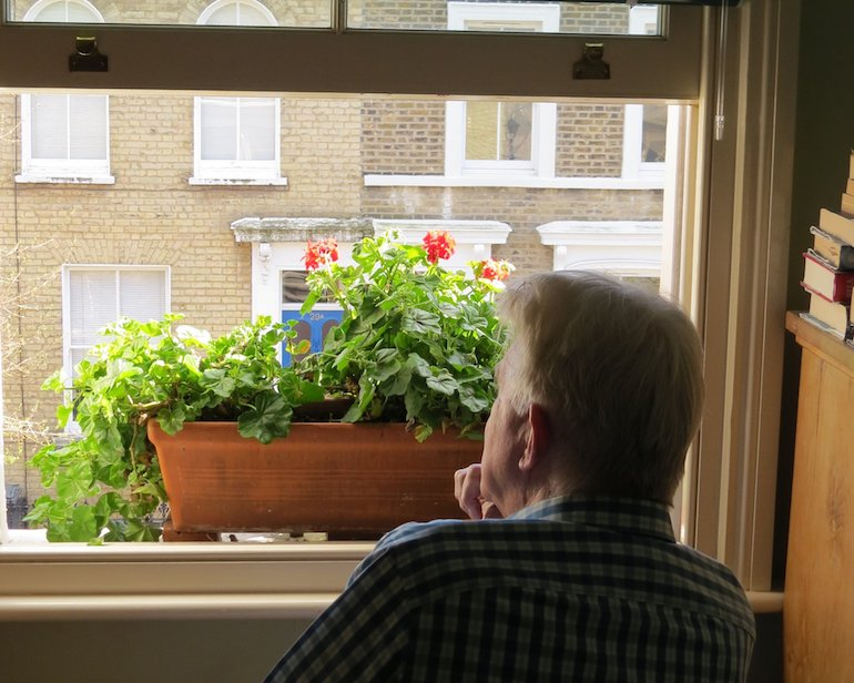 Steve looking out the window on Chisenhale Road, Bow, East London. Photo Credit: © Steve Fallon.