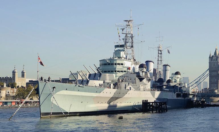 HMS Belfast on River Thames in London. Photo Credit: © Alvesgaspar via Wikimedia Commons.
