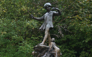 Peter Pan Monument in Kensington Gardens in London. Photo Credit: © Peter Clarke via Wikimedia Commons.