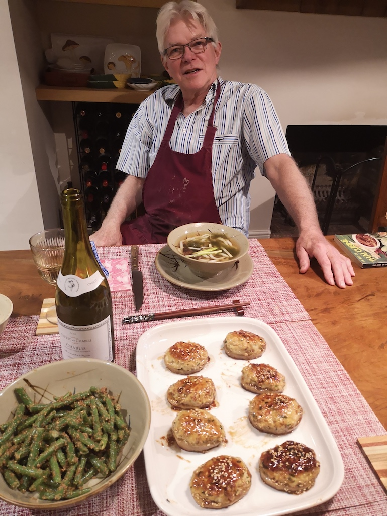 Steve with home-cooked miso soup, sesame green beans and chicken balls with lotus root dishes, Bow, East London. Photo Credit: © Steve Fallon.