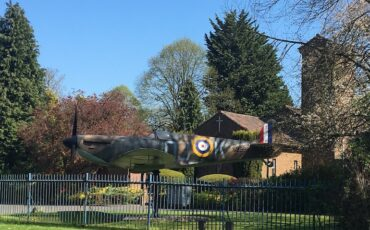 Spitfire in front of St George's Royal Air Force Chapel of Remembrance Biggin Hill. Photo Credit: © Ursula Petula Barzey.