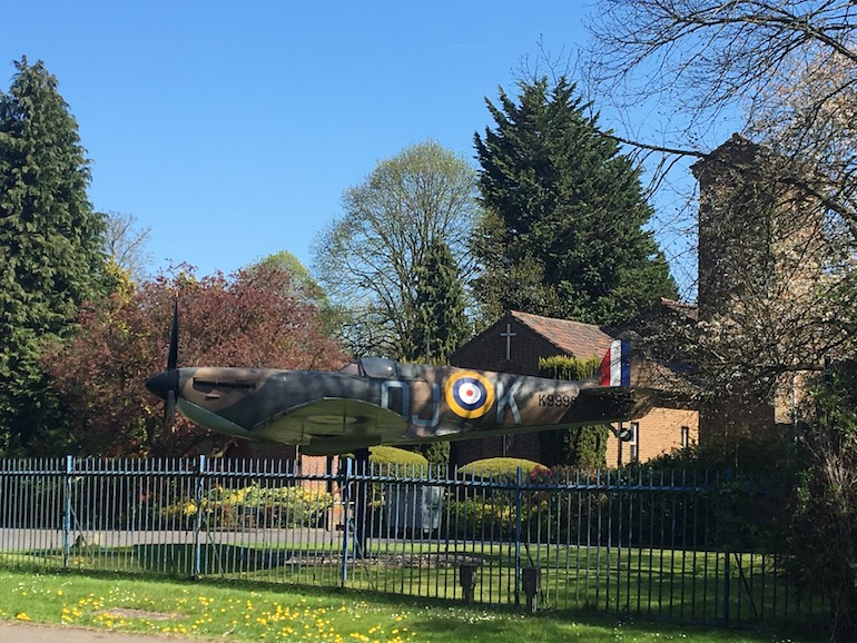 Spitfire in front of St George's Royal Air Force Chapel of Remembrance Biggin Hill. Photo Credit: ©Ursula Petula Barzey.