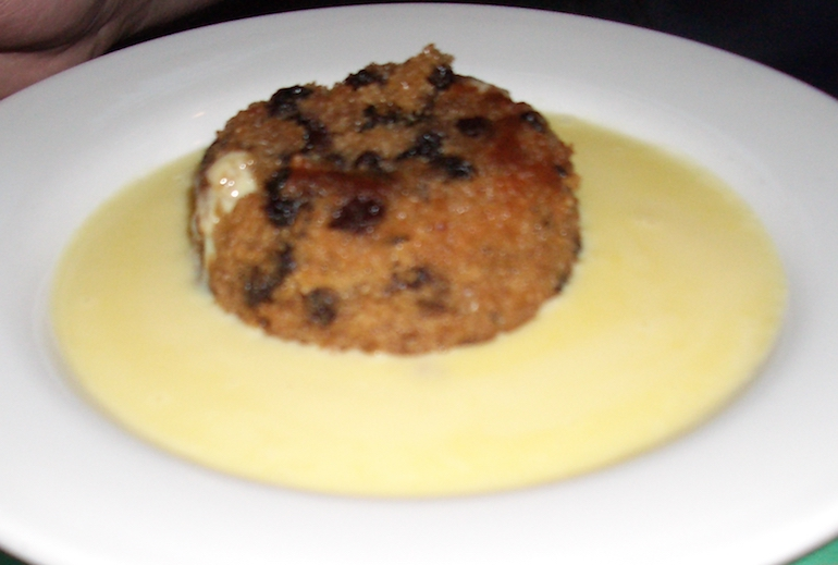 Spotted Dick and custard. Photo Credit: © Justinc via Wikimedia Commons.