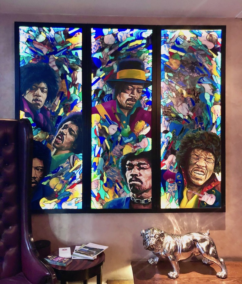 Jimi Hendrix inspired stained glass window in reception at Sanctum Soho Hotel. Photo Credit: © Ursula Petula Barzey.