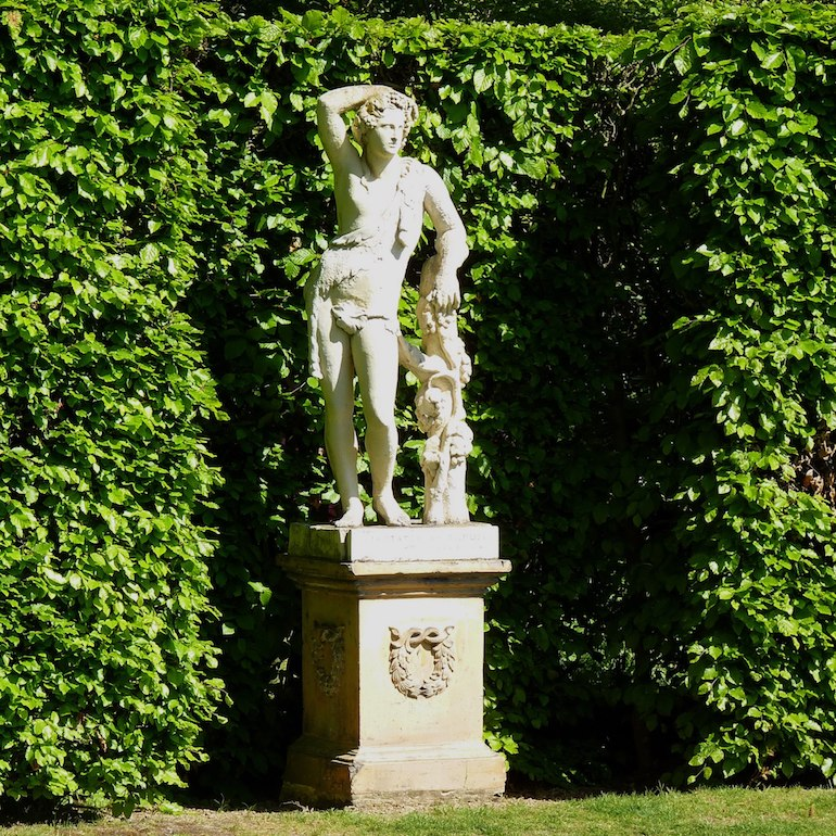 Statue in Sissinghurst Castle Gardens. Photo Credit: © Hans Bernhard via Wikimedia Commons.