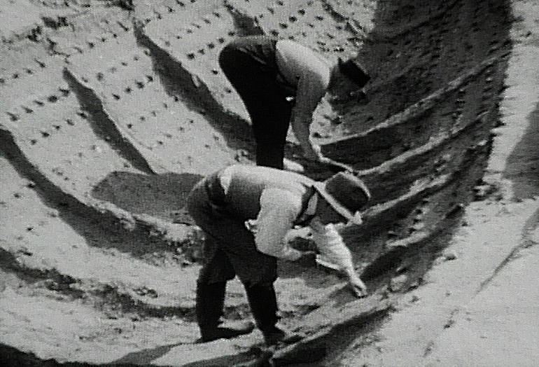 Basil Brown (front) and Lt. Cmdr. J. K. D. Hutchison excavating the 7th-century burial ship at Sutton Hoo in 1939. Photo Credit: ©Harold John Phillips via Wikimedia Commons.