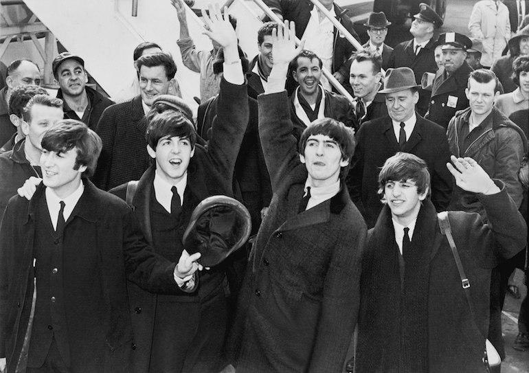 The Beatles arriving at John F. Kennedy International Airport, 7 February 1964. Public Domain via Wikimedia Commons.