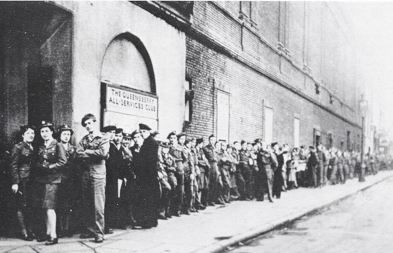 Queuing outside the Queensbury Club during World War II. Photo Credit: © Imperial War Museum.