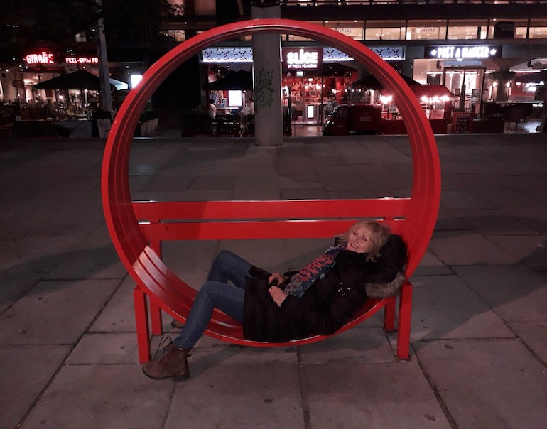 Gail Jones on a Jeppe Hein modified bench on the Southbank. Photo Credit: © Gail Jones.