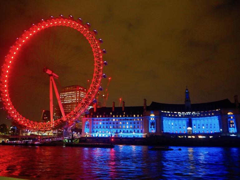 London Eye and County Hall illuminated at night. Photo Credit: © Ursula Petula Barzey.