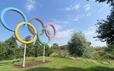 Queen Elizabeth Olympic Park_Olympic Rings with velodrome in distance. Photo Credit: © Sarah Wood.