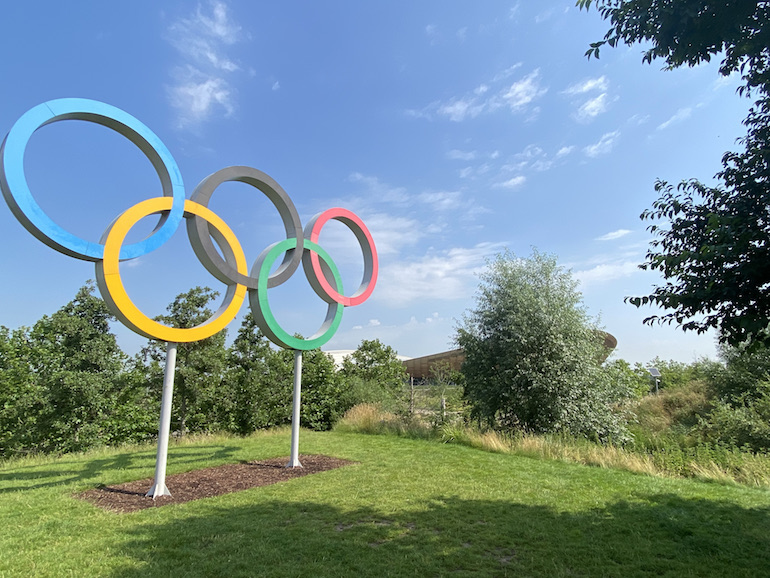 Queen Elizabeth Olympic Park_Olympic Rings with velodrome in distance. Photo Credit: © Sarah Woods.