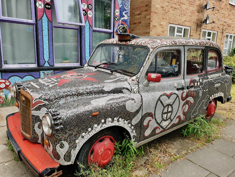 Black Cab in front of Carrie Reichardt Mosaic House, Chiswick area of London. Photo Credit: © Christopher Hayden.