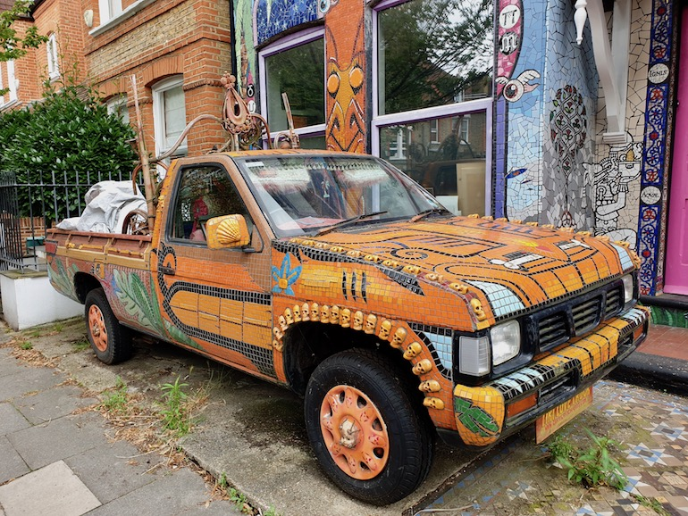Pickup in front of the Carrie Reichardt Mosaic House, Chiswick area of London. Photo Credit: © Christopher Hayden.