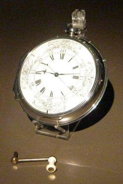 Harrison's sea watch No.1 (H4), with winding crank. Photo Credit: © Phantom Photographer via Wikimedia Commons.