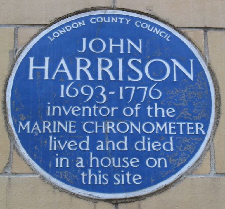 Blue plaque remembering John Harrison is located on the south side of 11 Red Lion Square, Holborn, London. Photo Credit: © Micronanopico via Wikimedia Commons.